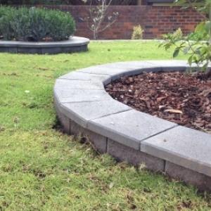 landscape landscaping concrete circular circle garden beds