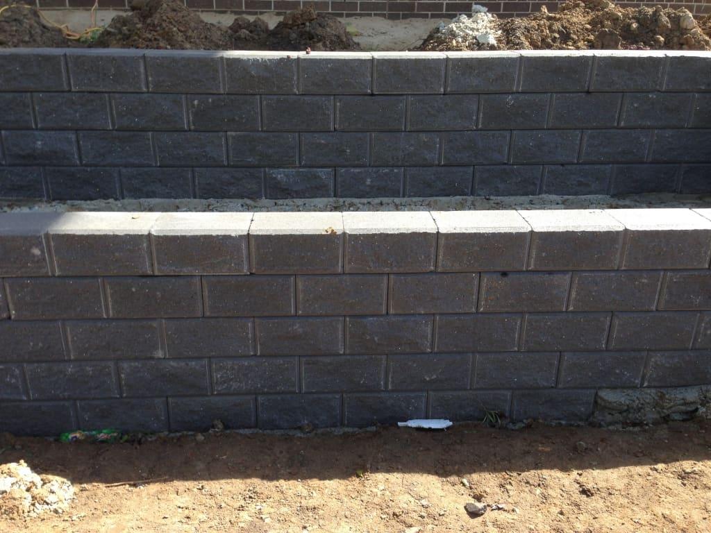brick wall grey landscaping retaining