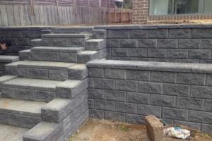 grey brick wall steps landscaping retaining