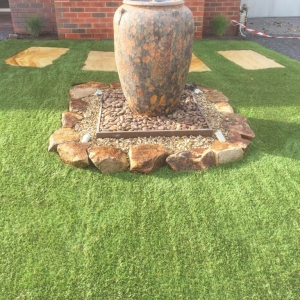 Urn, landscape gardening, water feature, pebbles, stones, sandstone, lawn, garden feature, garden rocks