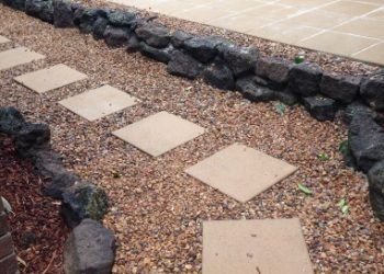 Concrete square tiles pebbles rocks landscaping