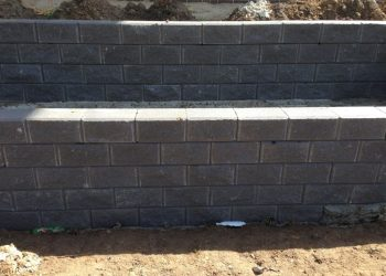 brick wall grey landscaping